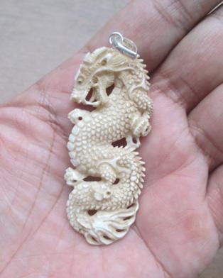 Brown dragon carved bone pendants for wholesale aloadofball Gallery