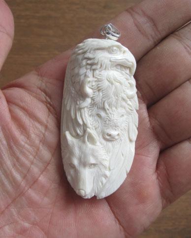 Eagle Bison Wolf Carved Bone Pendant