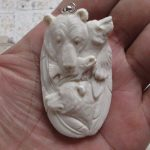 Bear Group Carved Bone Pendant