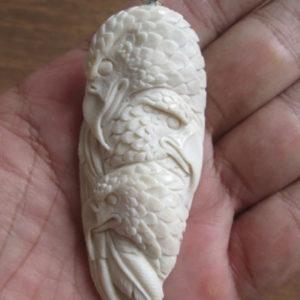 Eagle Group Carved Bone Pendant