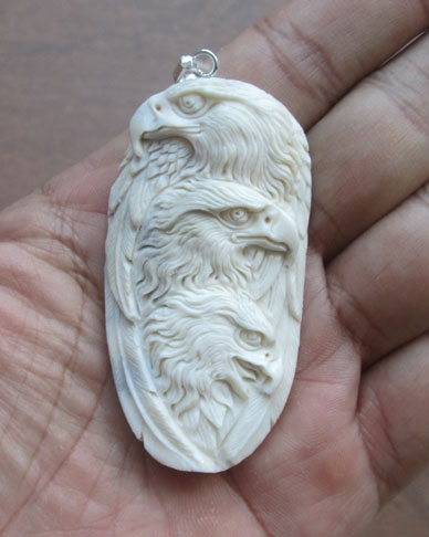 Eagle Group Carved Bone Pendant