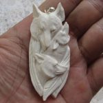 Wolf Group Carved Bone Pendant